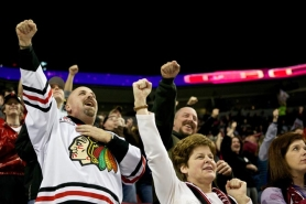 by: JAIME VALDEZ Cory Gillas of Vancouver and Kelly Ericsen of Forest Grove (lower right) celebrate after a Winterhawks scored a goal against Spokane last week at the Rose Garden.