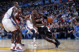 by: LAYNE MURDOCH Trail Blazer forward Gerald Wallace drives on Oklahoma City's Serge Ibaka en route to his 40 points in a losing cause.