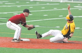 by: John Brewington INTO SECOND—St. Helens' Tyler Stewart slides safely into second during a recent game. The Lions won four games in Southern Oregon last week.