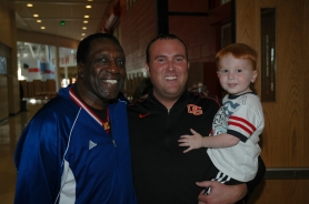 by: Submitted Photo Justin Walters, center, and his son pose with Harlem Globetrotters legend Meadowlark