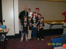 by: Submitted Photo Members of the Hayhurst Chess Club who competed in the Chess for Success state team tournament March 4 at the Oregon Convention Center pose with their second-place trophy.