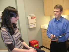 by: CLIFF NEWELL Dr. Kelly Leaf uses an electronic tablet to obtain patient information from Chelsea Hossani. The tablet is one of the many innovations Leaf is offering at Doctors Express.