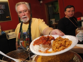 by: Vern Uyetake Tom Blanchette serves up shrimp creole and jambalaya at Sip D'Vine.
