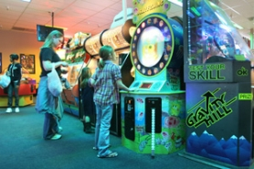 by: Jim Clark Jeni McIntoch, second from left, brought her children Jamie, 4, and Aleah, 7, from their home in Selah, Wash., to the Wunderland arcade in Gresham for an afternoon of arcade games on Monday, March 28.