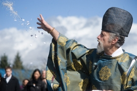 by: Chase Allgood Reverend Koichi Barrish throws salt during Saturday's Kura Blessing at SakéOne.