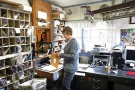 by: Jim Clark A pleasant clutter fills the office of the 100-square-foot Bridal Veil post office staffed by Geri Canzler.