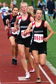 by: DAN BROOD LEADING THE WAY — Sherwood's Jessica Imbrie (right) and Kylie Thalhofer are in first and second place in the 1,500 at last year's NWOC district meet.