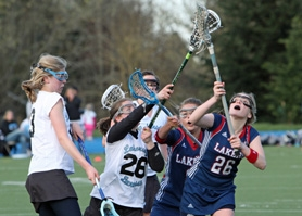 by: VERN UYETAKE Dana Kilsby, right, is a co-captain on the Lake Oswego girls lacrosse team this year. The senior midfielder was an honorable mention All-American last year.