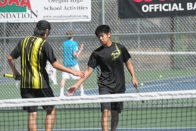 by: VERN UYETAKE Ken Tsuruta and Arthur To are the defending district doubles champions and anchor a strong doubles corps for the Lions this year.