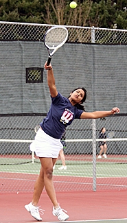 by: Miles Vance OVER THE TOP — Westview's Swetha Malineni serves during her Metro League victory at second singles against Aloha on Monday at Westview High School.