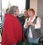by: Barbara Sherman ALWAYS LOTS TO DO — Rep. Margaret Doherty (right) chats with Tigard resident Cynthia Connor at a town hall in Tigard on March 12.