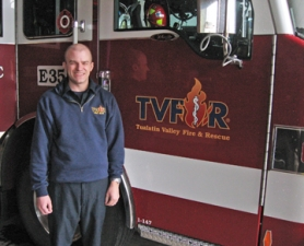 by: Barbara Sherman PROUD TO SERVE — Tualatin Valley Fire & Rescue firefighter John Sconce's dedication to his job and off-duty volunteer work for the Oregon Muscular Dystrophy Association helped him put him over the top for the annual award.