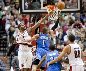 by: CHRISTOPHER ONSTOTT Blazer forward LaMarcus Aldridge tips away a shot attempt by Oklahoma City's Russell Westbrook.