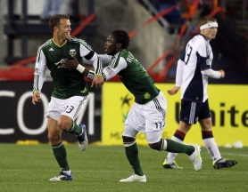 by: JIM ROGASH Jack Jewsbury (left) celebrates his goal with Portland Timbers teammate Kalif Alhasan during Saturday night's 1-1 draw with New England in Foxborough, Mass.