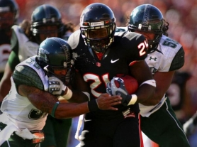 by: L.E. BASKOW Oregon State's Ryan McCants drives toward the goal line in a 2008 game versus Hawaii.