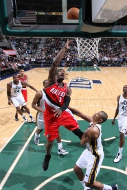 by: MELISSA MAJCHRZAK Gerald Wallace of the Trail Blazers puts up an inside shot, with Utah's Earl Watson and other Jazz players watching, en route to his game-high 29 points Thursday.