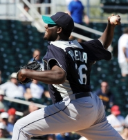 by: NORM HALL Michael Pineda delivers a pitch during spring training for the Seattle Mariners.