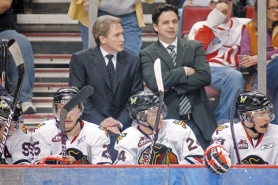 by: CHRISTOPHER ONSTOTT Behind their players on the bench, Portland Winterhawks General Manager/coach Mike Johnston (left) and his assistant Travis Green study the action during the Western Hockey League playoffs.