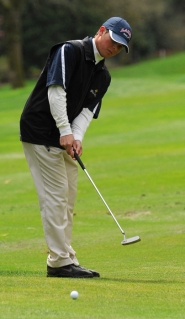by: Vern Uyetake Lake Oswego's Adam Ruben hits a putt during last week's league tournament at Oswego Lake Country Club.