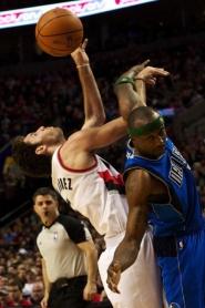 by: JAIME VALDEZ The Trail Blazers and Dallas Mavericks split four regular-season games, but Portland easily won 104-96 April 3 at the Rose Garden, where guards Rudy Fernandez (left) and Jason Terry of the Mavs tangled for the ball.