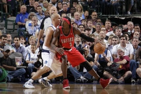 by: DANNY BOLLINGER Gerald Wallace (right) posts up Dallas guard Jason Kidd in Game 1 of the Trail Blazers' playoff series.