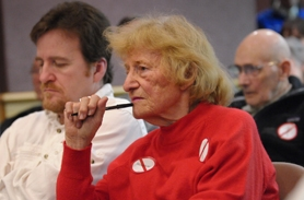by: VERN UYETAKE Kay Kerr, with Brad Kerr next to her, listens intently during the Lake Oswego City Council meeting Tuesday evening on the Lake Oswego to Portland streetcar issue. The Kerrs are among a sizable group opposing the streetcar.