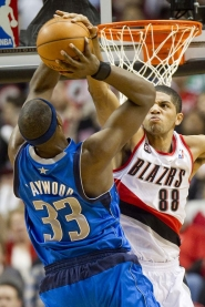 by: CHRIStopher Onstott Trail Blazer forward Nicolas Batum blocks a shot by Dallas' Brendan Haywood during Game 3 of their first-round playoff series Thursday at the Rose Garden.