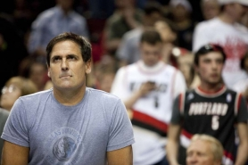 by: CHRIStopher Onstott Mark Cuban, Dallas Mavericks owner, watches the second half from behind the team bench Thursday night at the Rose Garden.