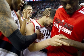 by: CHRIStopher Onstott An emotional Brandon Roy is greeted by teammates after giving the Trail Blazers the lead over Dallas late in Saturday's game at the Rose Garden.