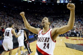 by: CHRISTOpher Onstott Blazer guard Andre Miller celebrates the comeback victory Saturday over Dallas.