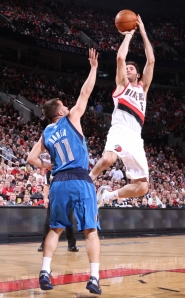by: SAM FORENCICH Rudy Fernandez of the Trail Blazers elevates for a short jumper over Dallas' Jose Barea during Game 3 of their Western Conference playoff series.