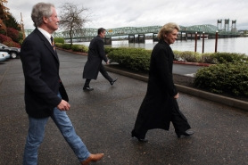 by: Jaime Valdez Govs. John Kitzhaber, left, and Chris Gregoire leave a press conference Monday morning outlining their plans to replace the aging Interstate 5 bridge (in the background).