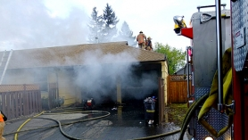by: Dick Harris Portland firefighters took about 20 minutes to extinguish a blaze at a Lents neighborhood house that damaged the dwelling and a 1968 Chevrolet Corvette.