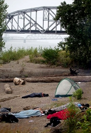 by: Christopher Onstott Homeless campers, like these on Hayden Island, could lose belongings during a sweep. Six homeless people are suing ODOT in federal court because they lost personal items in campsite sweeps.