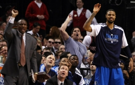 by: JONATHAN FERREY From behind the Dallas Mavericks bench, owner Mark Cuban argues a foul call in the Trail Blazer playoff series.