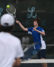by: VERN UYETAKE Lakeridge's Zach Calo, along with partner Jake Lautze, won at No. 1 doubles in the first of two matches with Lake Oswego.