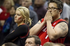 by: CHRISTOPHER Onstott Blazer fans look on as their team falls behind in the final minutes of Game 6 at the Rose Garden.