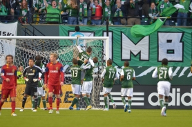 by: JOSH BRYAN After scoring in the 22nd minute, Kenny Cooper gets congratulations from Portland Timbers teammates as he hangs from the crossbar. The goal stood up, as the Timbers defeated Real Salt Lake 1-0 Saturday night at Jeld-Wen Field.