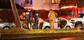 by: David F. Ashton After removing the pillars and rear door of the car in the middle of the crash – the Kia – firefighters extract the occupant and place her on a waiting gurney.