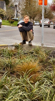 by: David F. Ashton Volunteer project leader Bradley Heintz, a Sellwood resident and a teacher, admires a completed crosswalk – and bio-swale – along S.E. 17th Avenue at S.E. Lambert Street.