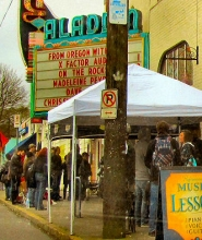 by: Eric Norberg By 10 am on April first, the initial line of several hundred audition hopefuls on the sidewalk outside the Aladdin Theater had dwindled to a couple dozen.