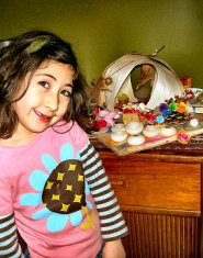 by: Rita A. Leonard Brooklyn resident Mina Motamedi, age 5, shows off one of the fairy houses she built from natural items and craft materials.