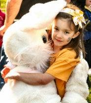 by: David F. Ashton Six-year-old Duniway Elementary School student Quinn Thomas gets a big hug from the Easter Bunny in Westmoreland Park.