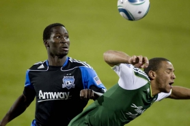 by: CHRISTOPHER Onstott Spencer Thompson (right) of the Portland Timbers takes an elbow in the back from Ike Opara of the San Jose Earthquakes.