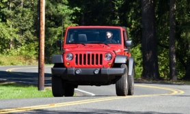 by: Courtesy of Northwest Automotive Press Association The seven-slot grill makes the 2011 Wrangler instantly recognizable as Jeep.