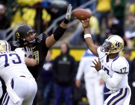 by: STEVE DYKES Ricky Heimuli, knocking down a pass by Washington's Keith Price during the 2010 season, could lead the Oregon Ducks' defensive line in 2011.