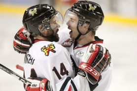 by: CHRISTOPHER ONSTOTT Craig Cunningham (left) celebrates with Ty Rattie after the latter's overtime goal gave the Portland Winterhawks a 4-3 overtime victory at home Friday night over the Kootenay Ice in the first game of the Western Hockey League championship series.