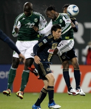 "by: JONATHAN FERRY Mamadou ""Futty"" Danso (left) heads in the decisive goal for the Portland Timbers on Friday night at Jeld-Wen Field."