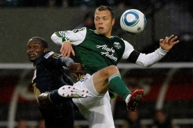 by: JONATHAN FERRY Former Jefferson High player Danny Mwanga (left), now with the Philadelphia Union, battles Portland Timbers veteran Jack Jewsbury in the rain at Jeld-Wen Field.
