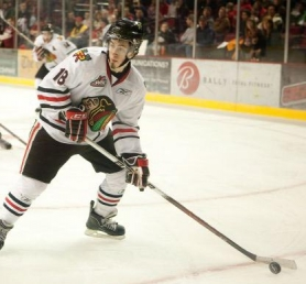 by: CHRISTOPHER ONSTOTT Brad Ross of the Portland Winterhawks drew a double-minor penalty and left the game in the second period, leading to a surge that gave the Kootenay Ice a 7-5 victory Saturday at the Rose Garden.